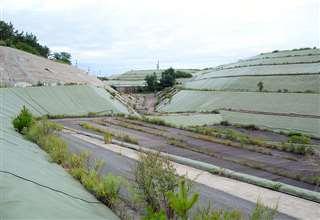 現在、県に管理されている能代産廃センター=昨年8月、能代市浅内