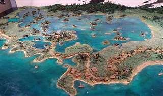 芭蕉が訪れた当時の象潟の模型。潟湖に浮かぶ大小の島々や、芭蕉一行が泊まった宿などが再現されている=にかほ市象潟郷土資料館