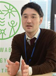 欧州の洋上風力の状況について説明する木村さん=東京都港区の自然エネルギー財団
